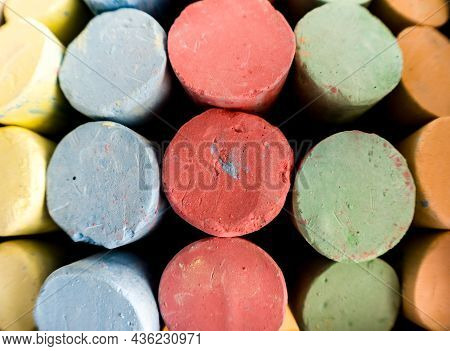 Close Up Background Photograph Image Of Colorful Sidewalk Chalk Including Red, Green, Blue, Yellow A