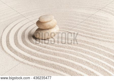 Stacked zen marble stones sand background in mindfulness concept