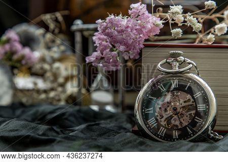 Pocket Watch, Blur Stack Of Old Book, Hourglass, Vintage Binocular And World Desk Globe On Dark Back