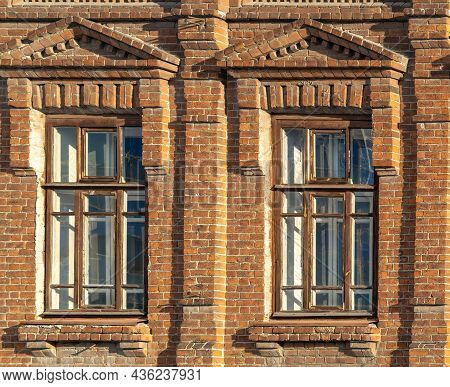 Two Windows Of The Old Mansion 19 Century With Brown Bricks Wall. Brick Wall Of An Old 19th Century