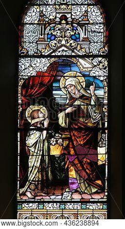 BOSILJEVO, CROATIA - JULY 15, 2012: Education of the Virgin Mary, stained glass window in the Church of St. Maurus the Abbot in Bosiljevo, Croatia