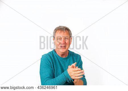 Portrait Of Handsome Caucasian Smiling Senior Man