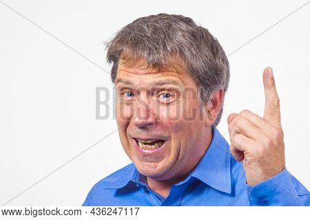 Man Gesturing And Warning With His Finger