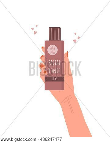 Skin Care Concept. Female Hand Holds Tube Of Facial Tonic. Morning Routine. Cleansing, Toning And Mo