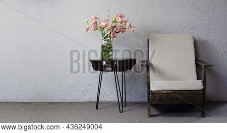 Wooden Coffee Table. Vase With Flowers. Loft Style Armchair. Wood Texture. Furniture. In The Room.
