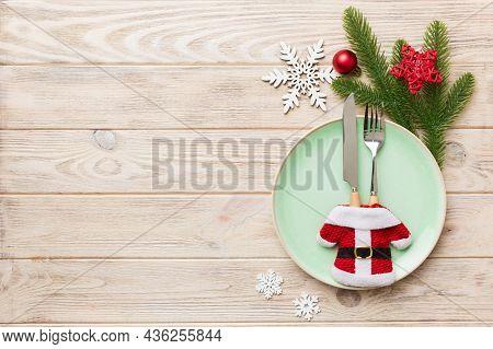 Christmas Table Place Setting With Christmas Decor And Plates, Kine, Fork And Spoon. Christmas Holid