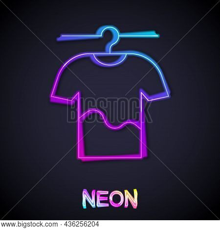 Glowing Neon Line Drying Clothes Icon Isolated On Black Background. Clean Shirt. Wash Clothes On A R