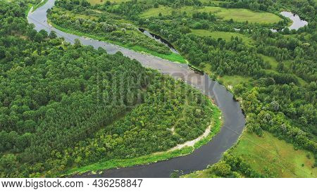 Aerial View Green Forest Woods And River Landscape In Summer Day. Top View Of Beautiful European Nat