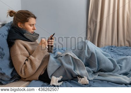 Caucasian Girl Lying In Bed, Touching Her Forehead, Suffering From Heat. Illness Cute Woman Tired Of