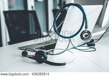 Headset And Doctor Equipment At Clinic Ready For Actively Support For Patient By Online Video Call .