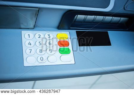 View From Above Of New Atm Keypad Numbers With French Text Engraved On Yellow Green Red Button Corre