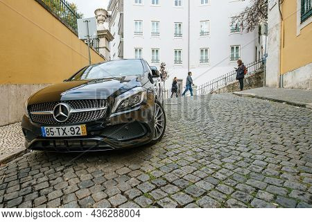 Lisbon, Portugal - Feb 9, 2018: Luxury Mercedes-benz Coupe Car Parked On The Cobblestone Road In Cen