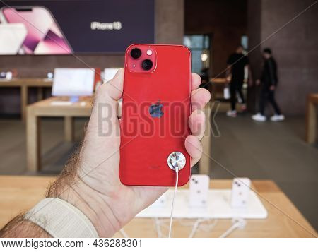 Paris, France - Sep 24, 2021: Customer Holding New Iphone 13 During Launch Day Inside Apple Store As