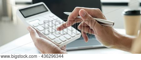 Work From Home, The Hand Of A Man Who Works In Finance Sits At His Desk At Home And Calculates Finan