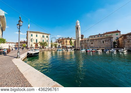Lazise, Italy - May 26, 2021: Port Of The Small Lazise Village, Tourist Resort On The Coast Of Lake