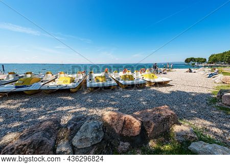 Bardolino, Italy - May 26, 2021: Group Of Paddle Boats (pedalo) For Rent On A Beach Of The Lake Gard