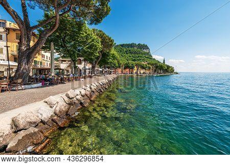 Garda, Italy - May 26, 2021: Lakeshore Of Lake Garda (lago Di Garda) With Outdoor Restaurants And Ba
