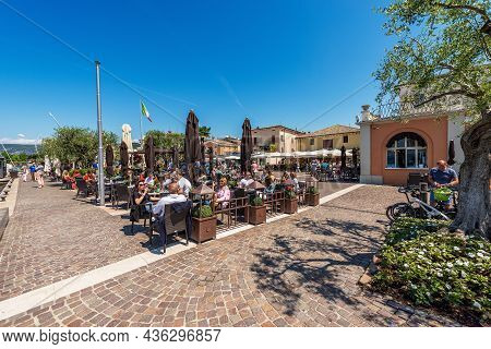 Bardolino, Italy - May 26, 2021: Outdoor Restaurants With Many People In The Small Village Of Bardol