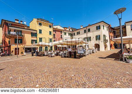 Garda, Italy - May 26, 2021: Downtown Of Garda, Tourist Resort On The Coast Of Lake Garda (lago Di G