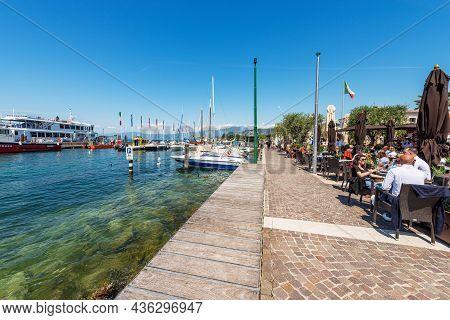 Cisano, Italy - May 26, 2021: Port Of The Small Village Of Cisano Di Bardolino With Many Boats Moore