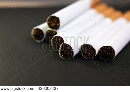 A Lot Of Cigarettes Piled Together On A Black Background. The Concept Of World No Tobacco, Tobacco A