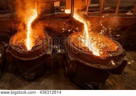 A Jet Of Molten Steel Is Poured Into Ladles. Metallurgical Industry.