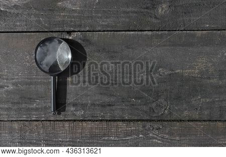 Magnifying Glass On Wood Aged Background With Copy Space For Text. Wooden Banner With Copyspace.