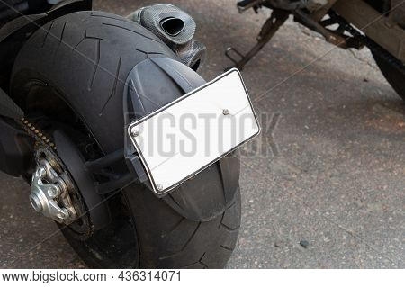 Empty Licence Plate On Rear Wheel Of Motorcycle. Vehicle Registration On Motorbike With Copy Space
