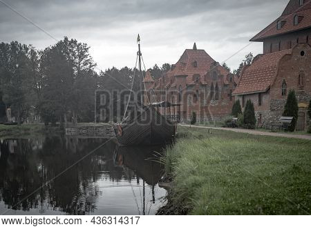 Medieval Castle And Ship Of Middle Ages. Historical Landscape.