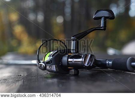 Reel Of Fishing Rod, Scissors, Extractor Close Up. Fishermans Equipment.