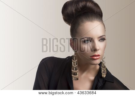 Fashion Brunette With Bag Looks At Left