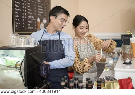 Baristas Making And Preparing A Cup Of Coffee In Coffee Shop
