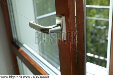 A Loosely Closed Balcony Door And A Gap Left, Indoor Closeup