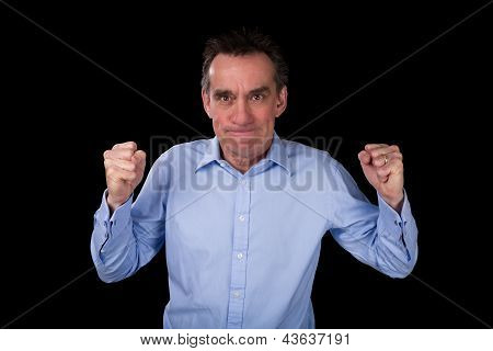 Angry Business Man Shaking Fists In Frustration