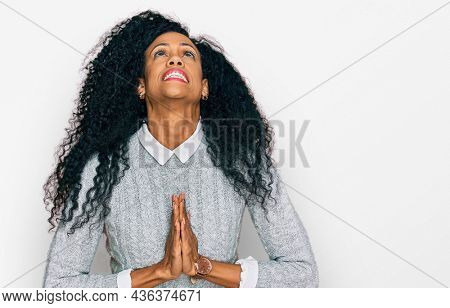 Middle age african american woman wearing casual clothes begging and praying with hands together with hope expression on face very emotional and worried. begging.