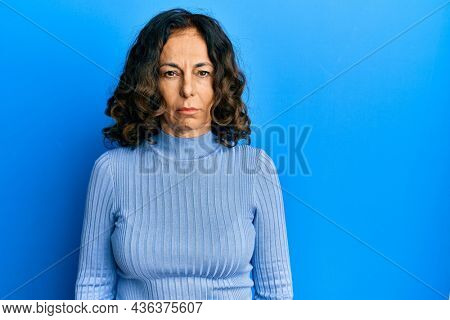 Middle age hispanic woman wearing casual clothes skeptic and nervous, frowning upset because of problem. negative person.