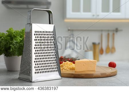 Grater And Cheese On Table In Kitchen. Space For Text