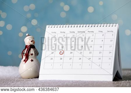 Saint Nicholas Day. Calendar With Marked Date December 19 And Snowman Figure On Table Against Blurre
