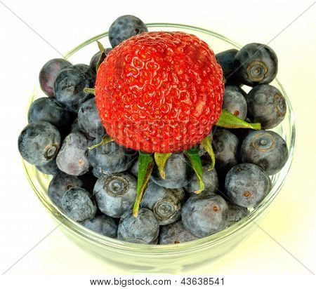 Blueberries and a strawberry