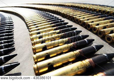 Shells For A Heavy Machine Gun. Military Aviation Ammunition Lies On The Concrete Floor. Preparing F
