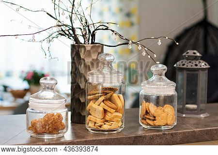 Glass Jars With Cookies. Glass Jars With Various Cookies And Crackers.