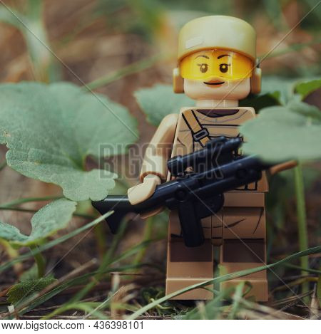 Chernihiv, Ukraine, July 13, 2021. A Figure Of A Girl Soldier With A Rifle Among The Plants. Illustr