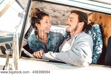 Hipster Couple Driving At Roadtrip On Oldtimer Mini Van Transport - Travel Lifestyle Concept With In