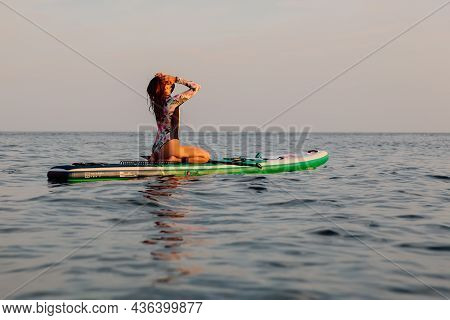 August 4, 2021. Anapa, Russia. Sporty Woman On Stand Up Paddle Board At Quiet Sea With Evening Light
