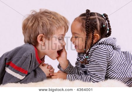 Two Kids Playing Face To Face