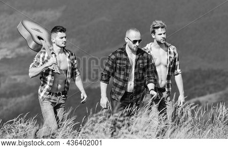 Enjoying Freedom Together. Men With Guitar Hiking On Sunny Day. Tourists Hiking Concept. Hiking With