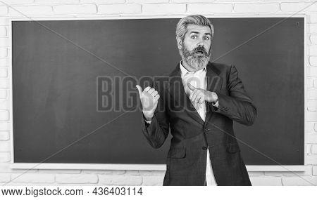 Teacher Explain Topic. Man Teacher In Front Of Chalkboard. Have Good Grade Point Average In High Sch