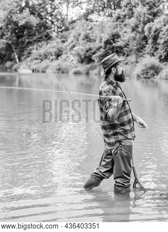 The Best Time To Go Fishing. Summer Weekend. Big Game Fishing. Mature Man Fly Fishing. Man Catching