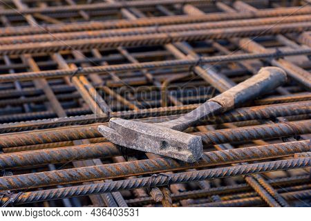 Special Hammer. Hammer For The Worker Engaged In The Installation Of Formwork For Concreting. Constr