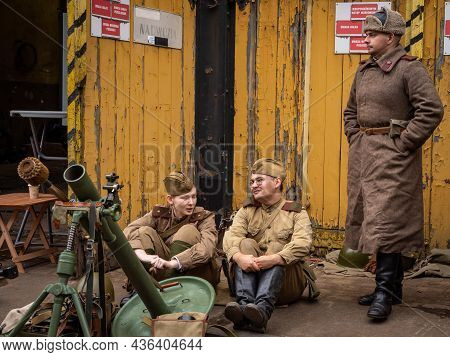 Wroclaw, Poland - September 19, 2021: Three Soviet Soldiers Dressed In Military Uniforms, Surrounded